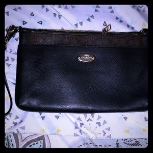 Great condition. Convertible leather wristlet.